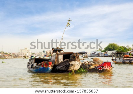 Trader' s boats tied together to be a shop floated on the river in several days until the  agricultural products are sold out. - stock photo