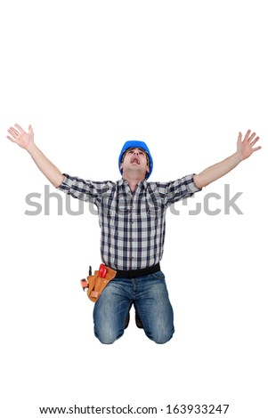 Tradesman crying out in fear - stock photo