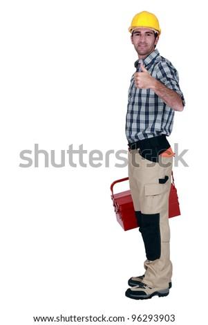 Tradesman giving the thumb's up - stock photo