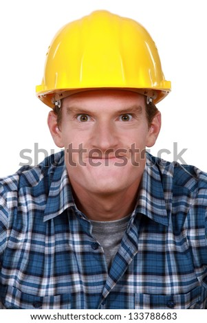 Tradesman making a silly face - stock photo