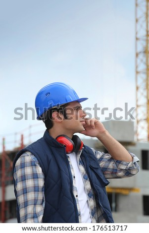 Tradesman working on a construction site - stock photo