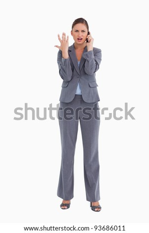 Tradeswoman getting bad news via cellphone against a white background - stock photo