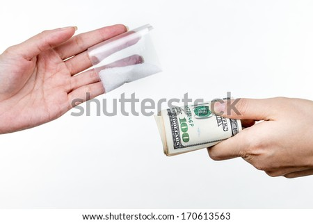 Trading money for drugs - stock photo