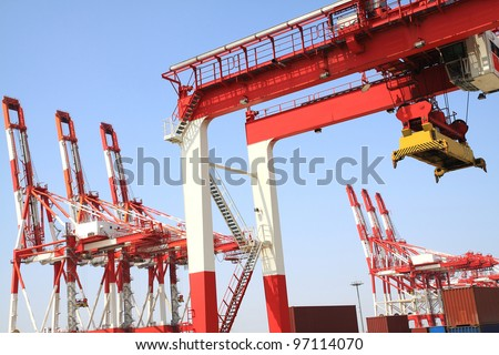 Trading port cranes and container storage - stock photo