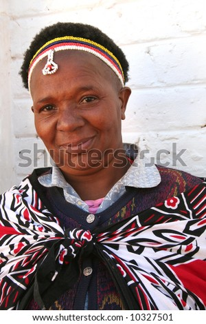 Traditional african woman with beads and traditional clothing - stock photo