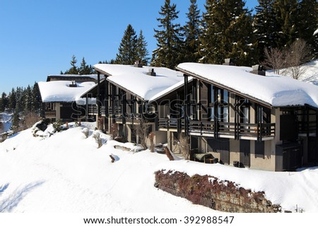 Traditional alpine cabins in the mountains of the Swiss Alps, Switzerland. - stock photo