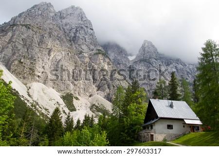 Traditional alpine house in the Julian Alps, Slovenia - stock photo