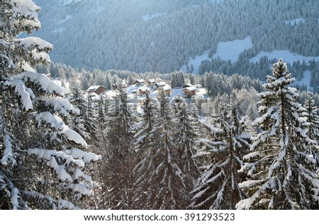 Traditional alpine huts in a snowy, winter setting in the Alps in Barboleuse, Gryon, Switzerland. - stock photo