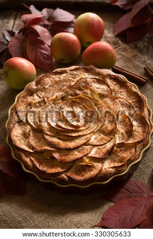 Traditional American holiday celebration apple pie sweet baket dessert food with cinnamon and apples on vintage background. Autumn decor. Rustic style and natural light. - stock photo