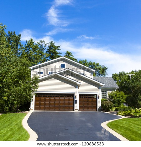 Traditional American Home with Garage - stock photo