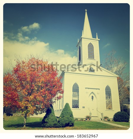 Traditional American white church in the fall with Instagram effect filter - stock photo