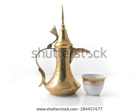 Traditional arabic coffee mug and coffee cup - stock image - stock photo