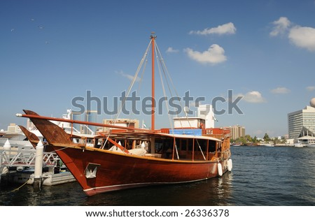 Traditional arabic Dhow at Dubai Creek - stock photo