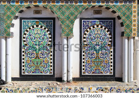 Traditional Arabic Mosaic in Tunisia (Medina). Painted tiles. Co - stock photo