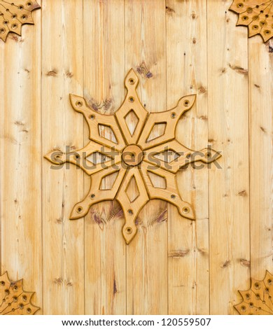 Traditional art of wood carving in russian village - stock photo
