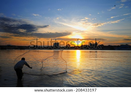 Traditional Asian Casting at river - stock photo