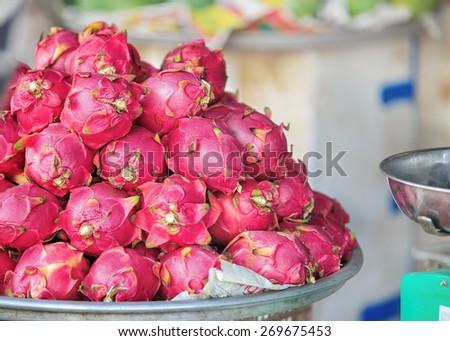 Traditional asian fish market stall full of fresh Dragon fruit  - stock photo