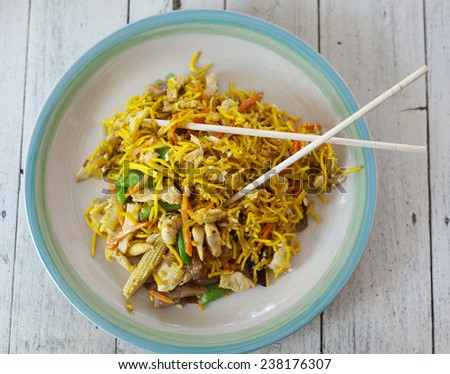 traditional asian food, pad thai, noodles with vegetables and meat on the table - stock photo