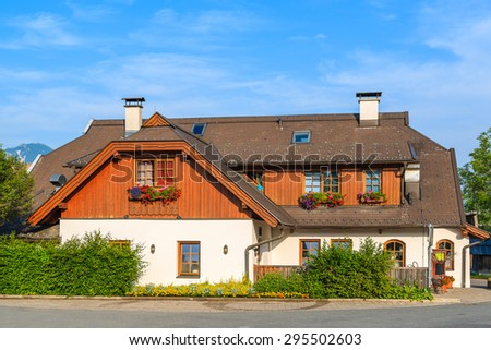 Traditional Austrian house in countryside area of Weissensee lake, Austria - stock photo
