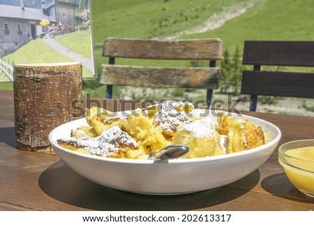 "Traditional austrian sweet scrambled eggs specialty"" Kaiserschmarrn "", served at an austrian mountains inn - stock photo"