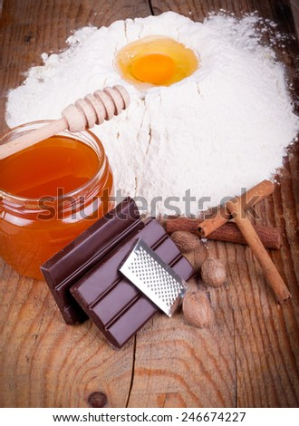 traditional baking ingredients on old wood - stock photo