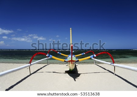 traditional balinese fishing boat on sanur beach, bali, indonesia - stock photo