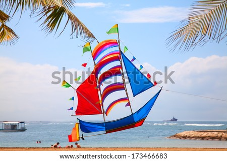 Traditional balinese kite in the sky - stock photo