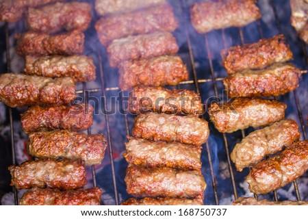 "Traditional Balkanian meet balls ""cevapcici"" on grill - stock photo"