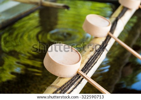 Traditional bamboo water scoop - stock photo