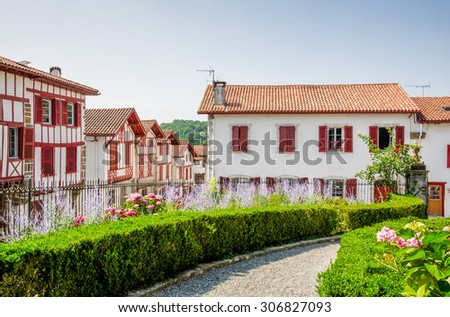 Traditional Basque houses in La Bastide-Clairence. - stock photo