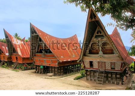 Traditional Batak houses on Samosir island, Sumatra, Indonesia, Southeast Asia - stock photo