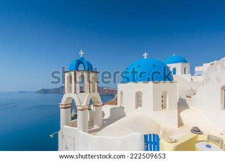 Traditional blue dome church in Santorini Greece - stock photo