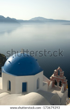Traditional blue dome church with beautiful view of the sea in Santorini  Greece  - stock photo