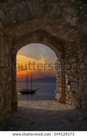 Traditional boat at sunset in Santorini island, Greece - stock photo
