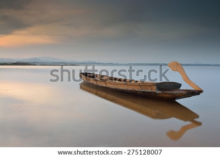 Traditional boat on the lake - stock photo