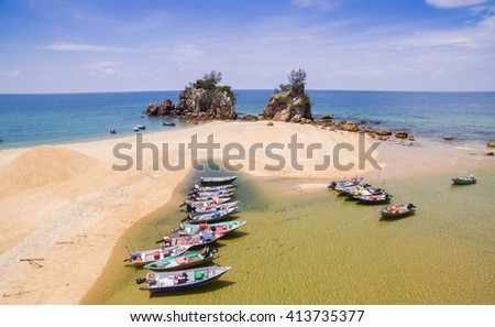 traditional boat park at the beach - stock photo