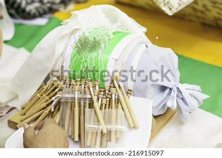 Traditional bobbin lace, detail of a women weaving, ancient tradition - stock photo
