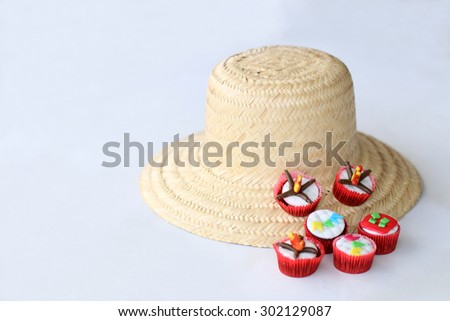 Traditional Brazilian hay hat and cupcakes decorated for celebrating St John  - stock photo