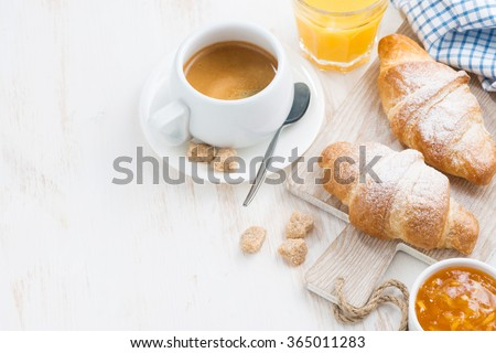 traditional breakfast with fresh croissants and white wooden background, top view, horizontal - stock photo