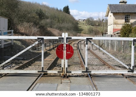 Traditional British level crossing with gates. - stock photo
