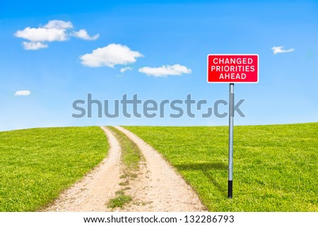 traditional british road sign priorities changed ahead on rural road leading to the top of the hill - stock photo