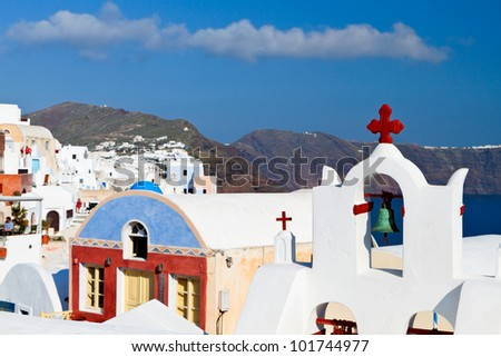Traditional campanile at Oia village at Santorini island in Greece - stock photo