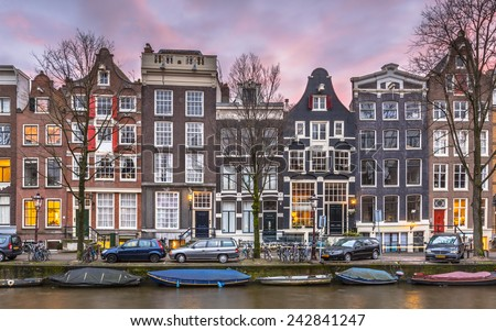 Traditional canal houses in many colors on Brouwersgracht in the grachtengordel the UNESCO World Heritage site of Amsterdam - stock photo