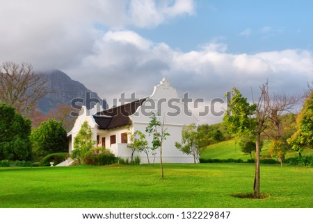 Traditional Cape Dutch house after rain. Shot in Helderberg nature reserve, near Somerset West, Cape town, Western Cape, South Africa. - stock photo