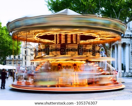 Traditional carousel with running horses for the children - stock photo