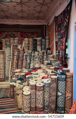 traditional carpet shop in tunisia - stock photo