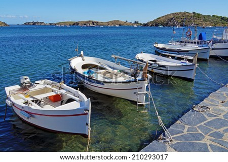 Traditional Catalan boats in the Mediterranean village of Cadaques, Costa Brava, Spain - stock photo