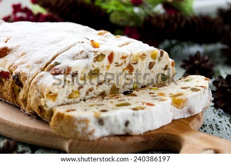 traditional cheese Stollen with dried fruit and pistachios - stock photo