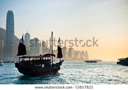 Traditional Chinese Boat on Victoria Harbour, Hong Kong. - stock photo