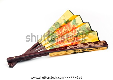 Traditional Chinese fan in the floor when folded isolated on white background - stock photo